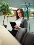 Young business woman working with the tablet in office Royalty Free Stock Photo