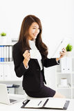 Young business woman working with tablet in office Stock Photos
