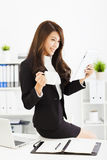 Young business woman working with tablet in office Royalty Free Stock Images