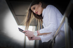 Young business woman working on a tablet on the terrace Stock Photo