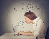 Young business woman working typing on computer in office royalty free stock images