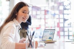 Free Young Business Woman Working With Laptop And Analyzing Business Report Document In Co-working Or Coffee Shop. Business People Work Royalty Free Stock Photos - 128840548