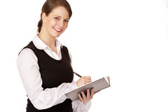 Young business woman writes on notepad Royalty Free Stock Photo