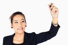 Young Business Woman writes something Stock Image