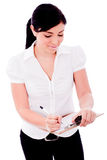 Young business woman writing in a clip Board Stock Photography