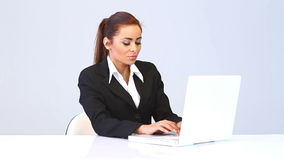 Young business woman writing on computer stock footage