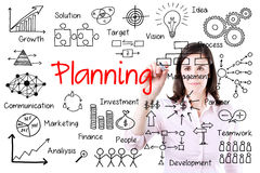Young business woman writing planning concept. Isolated on white. Stock Photo