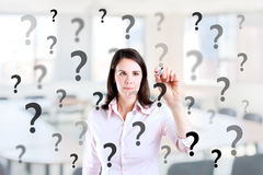 Young business woman writing question mark. Stock Photo