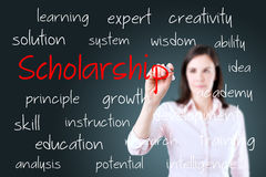 Young business woman writing scholarship concept.  stock image