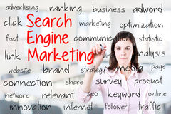 Young business woman writing search engine marketing concept. Office background. Stock Image