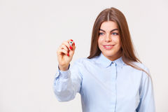 Young business woman writing on a transparent copyspace Stock Image