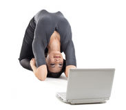 Young business woman in yoga pose look at notebook Royalty Free Stock Photos