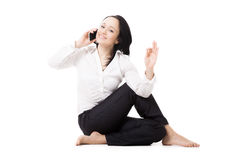 Young business woman in yoga pose making call on white backgroun Stock Photos