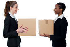 Young business womans holding small boxes Royalty Free Stock Photo
