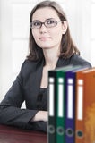 Young business women. Young business woman with bunch of files folders Stock Image