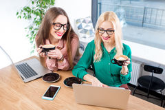 Young business women at the cafe Stock Photography