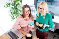 Young business women at the cafe Stock Images