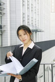 Young business women with file Stock Photos