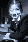 Young business women with file. Young chinese secretary or businesswoman in suit with notebook Stock Photography