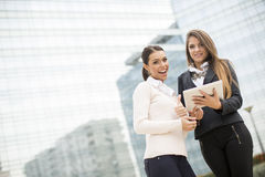 Young business women in front of office building Stock Image