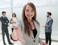 Young business woman holding out her hand for a handshake stock photos