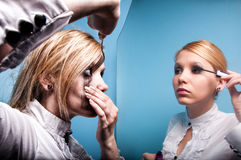 Young business women in a mirror, dual personality Stock Photo
