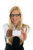 Young business women showing business card. Focus on business card. Isolated on white Royalty Free Stock Photography
