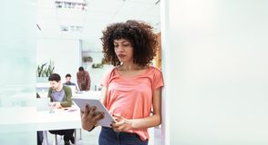 Young business woman in coworking office royalty free stock photo