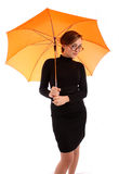 Young business women with umbrella Stock Photography