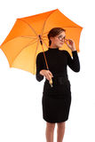 Young business women with umbrella Stock Photos