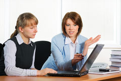 Young business women working on laptop Stock Photography