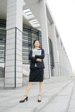 Young business women woth file. Young chinese secretary or businesswoman in suit with notebook Royalty Free Stock Image