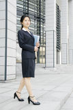 Young business women woth file Stock Photos