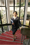 Young business women woth file. Young chinese secretary or businesswoman in suit with notebook Stock Image