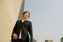 Young business women woth file. Young chinese secretary or businesswoman in suit with notebook Royalty Free Stock Photos