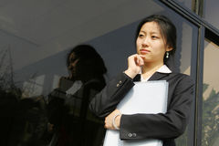 Young business women woth file. Young chinese secretary or businesswoman in suit with notebook Stock Photography