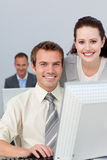 Young business workers in front of a computer Stock Photography