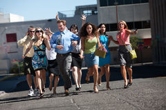 Young business workers run down steet. Royalty Free Stock Photo