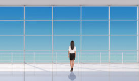 Young businesslady standing back Royalty Free Stock Images