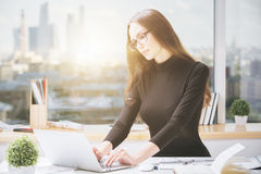 Young businesslady using laptop Stock Photo