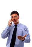 Young businessman. Using mobile phone royalty free stock image