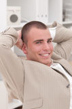 Young businessman. Relaxing in his office Royalty Free Stock Photos