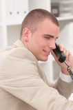 Young businessman. Talking on the phone Stock Image