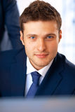 Young Businessman. Closeup portrait of smiling young businessman working at the office Stock Image