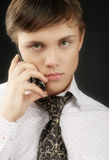 Young businessman. With mobile phone , looking serious and tired Stock Images
