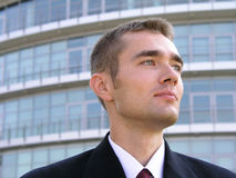 Young Businessman. Businessman standing outside a modern office building Royalty Free Stock Photo