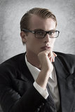 Young businessman. Thoughtful looking at camera Stock Image