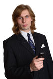 Young businessman. A young businessman making a call on his cell phone looks smart in a pinstriped suit and tie Stock Photo