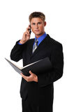 Young businessman. On a cell phone isolated on a white background Stock Photography