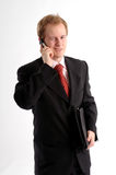 The young businessman. The happy young blond attractive businessman in dark suit Royalty Free Stock Photography